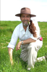 Richard Graham, Landtasia Organic Farm Founder. on certified grass-fed beef pasture.